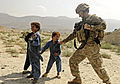 US Soldier plays with Afgan kid.jpg