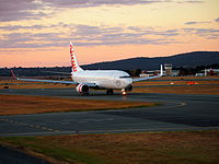 A Virgin Australia Boeing 737 taxiing at sunset