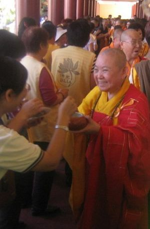 Women and religion - A high-ranking Bhikkhuni in the Chinese Buddhist tradition during an alms round.
