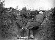 Vickers machine gun crew with gas masks rear view