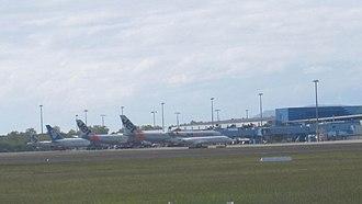 Cairns Airport - View of Cairns international terminal with an Air New Zealand 767, Air Niugini F100, a Jetstar A321 and 2 Jetstar A330s, 11 June 2010