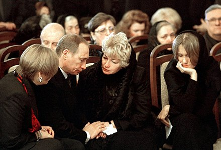 Vladimir Putin, Lyudmila Narusova and Ksenia Sobchak at the funeral of Putin's former mentor Anatoly Sobchak, Mayor of Saint Petersburg (1990-1996). Vladimir Putin 24 February 2000-2.jpg