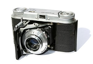 A photo of a Voigtlander Vito II camera with a...