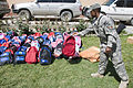 Volunteers sort, pack school supplies (4525006347).jpg