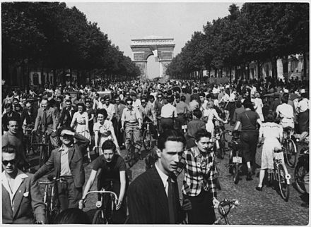 "French people in Paris, August 1944 WWII, Europe, France, Civilians, ""Hour of Triumph, Parisians join the parade down Champs Elysees from the Arch de... - NARA - 196298.jpg"