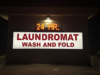 Self-service laundry - Photo of a laundromat sign in El Paso, TX, which offers a wash and fold service.