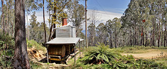 The Washington Iron Works Skidder in Nuniong is the only one of its kind in Australia, with donkey engine, spars, and cables still rigged for work. Washington winch panorama.jpg