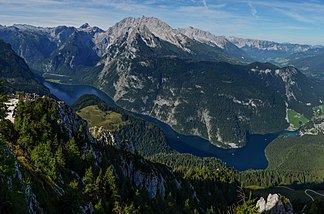 The central ridge mountains of Watzmann and Hochkalter in front of the high plateaus of the Steinernes Meer and the Reiter Alm. The Königssee runs right through the picture.