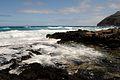 Waves breaking on the rocks. (4573657817).jpg