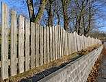 Wavy fence on a wall.jpg