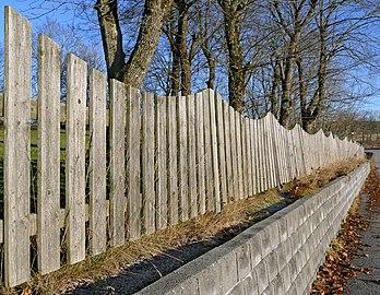 Wavy fence on a wall.jpg