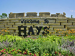 Stone work sign that greets visitors coming into Hays