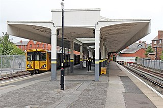 Railway station on the West Kirby branch of the Merseyrail Wirral line in England