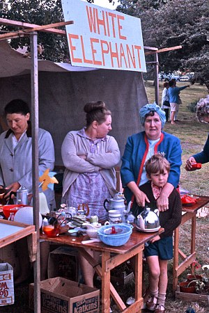 White elephant sale - White elephant sale at English country fair, 1971
