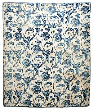 Quilting - This early American wholecloth quilt was made in the Colonial period, c. 1760-1800. The blue resist fabric includes bold, fanciful botanical motifs. Collection of Bill Volckening.