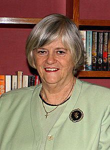 Photograph of the upper body of a 63-year-old Ann Widdecombe wearing a small crucifix