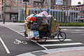 Woman Riding Tricycle Loaded Recycle Items in Songshan Road, Songshan District, Taipei 20150316.jpg
