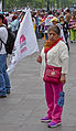 Woman holding flag at political demonstration in Mexico City.jpg