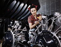 Woman working on an airplane motor at North American Aviation, Inc., plant in Calif.jpg
