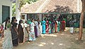 Women voters in a queue, waiting for their turn to exercise franchise rights during assembly election-2006 at Mondaikadu in Kanyakumari, Tamil Nadu on May 08,2006.jpg