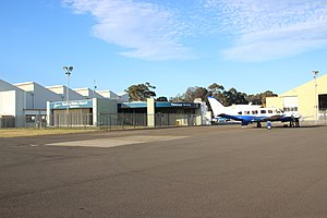 Bankstown Airport - Bankstown Airport's passenger terminal with a Piper Chieftain on the right, October 2016