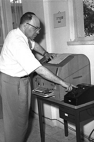 Government Press Office (Israel) - Postal Minister Yosef Burg dedicating the first Telex machine in the Government Press Office, August 1956