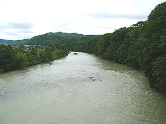 Yūbari River - View from an open train window on the Sekishō Line between Numanosawa Station and Minami-Shimizusawa Station (August 2006)