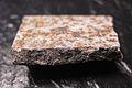 Zhovtnevyi meteorite, fusion crust.jpg