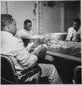 """Steward's mates joke as they dry silverware in the wardroom of U.S.S. Ticonderoga (CV-14)."", 11-1944 - NARA - 520869.tif"