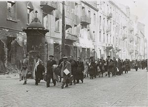 Umschlagplatz - Jews captured during the Warsaw Ghetto Uprising being led to Umschlagplatz via Zamenhof street.