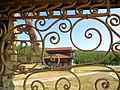 Вид на Дом Танской сквозь кованую решетку.JPG