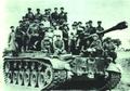 195106 1951年朝鲜战争中慰问团廖承志 被俘美军坦克.png