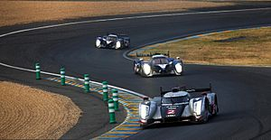 2011 24 Hours of Le Mans - The No. 2 Audi leading a duo of Peugeots