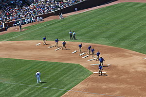 Groundskeeping - Wrigley Field Grounds crew smooths the infield dirt.