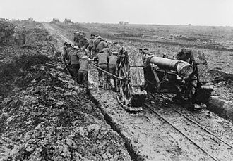105th Siege Battery, Royal Garrison Artillery - 6-inch howitzer being moved through mud on the Western Front.