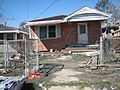 7Feb06Low9thBrickSlippedHouse.jpg