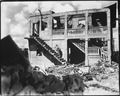 A Marine from the Third Marine Division goes after a sniper in a shelled building. Guam, August 1944. - NARA - 532568.tif
