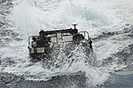 A U.S. Marine Corps assault amphibious vehicle prepares to enter the well deck of the amphibious assault ship USS Bonhomme Richard (LHD 6) in the East China Sea March 11, 2014 140311-N-LM312-198.jpg