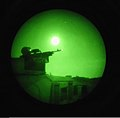 A U.S. Soldier, with Charlie Company, 1st Combined Arms Battalion, 194th Armored Regiment, 34th Infantry Divison, Minnesota National Guard, sits in a gunner's turret during night fire gunnery qualification 110707-A-RS556-940.jpg
