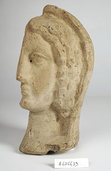 A clay-baked face. Roman votive offering Wellcome L0035919.jpg