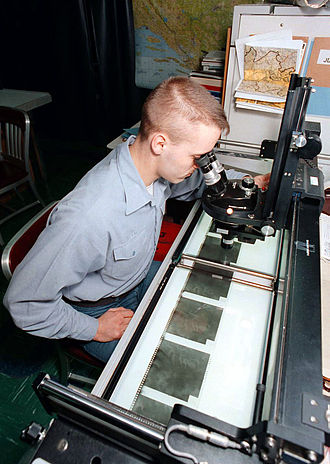 Light table - TARPS Intelligence Specialist uses a light table to analyze film from KS-87 camera.