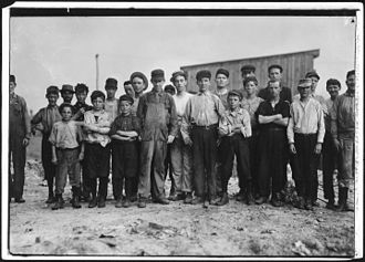 Alexandria, Virginia - Child laborers working at a glass factory in Alexandria, 1911.  Photo by Lewis Hine.