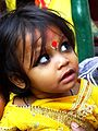 A girl in yellow religious dress for Vasant Panchami Festival in Kolkata.jpg