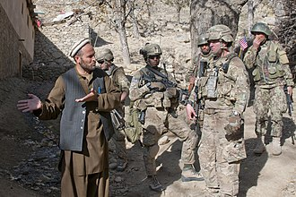45th Infantry Brigade Combat Team (United States) - 45th Infantry Brigade Combat Team and Afghan soldiers speaking with a civilian in 2011