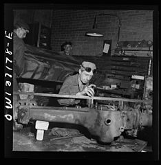 A mechanic working on a rear axle housing at the Greyhound garage 8d32906v.jpg