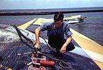 A sailor mechanic refueling a plane at the Naval Air Base, Corpus Christi,1a34918v.jpg