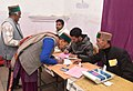 A woman voter being registered her name to cast her vote, at a polling booth, during the Himachal Pradesh Assembly Election, in Kalpa, dist. Kinnaur, Himachal Pradesh on November 09, 2017.jpg