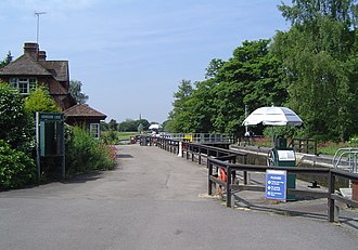 Abingdon Lock - Abingdon Lock with Abingdon downstream in the distance. The silver parasols are to shade the lock-keeper while operating the controls. Yellow boards on the gates indicate a high stream
