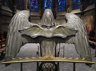 Lectern - Eagle lectern in the choir hall of Aachen cathedral with a bat cast in 1874 in Stolberg. The bat on the eagle's back serves to stabilize the damaged lectern.