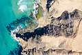 Aerial view of volcanic mountains at the beach Playa del Viejo Reyes on Fuerteventura, Canary Islands.jpg